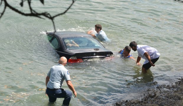 Police saving woman from sinking BMW